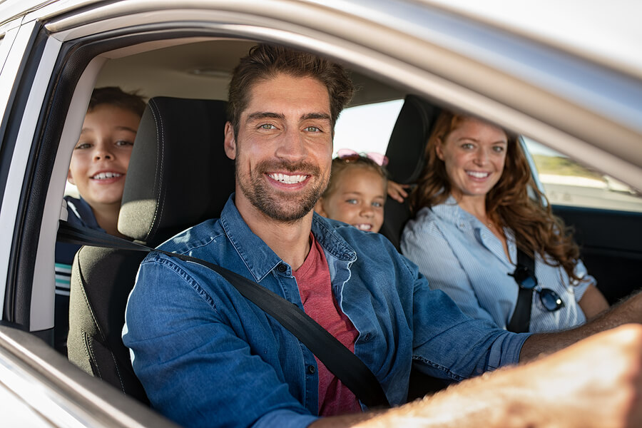 Happy family driving car