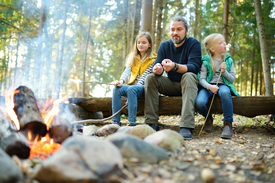 Camping dad kids fire