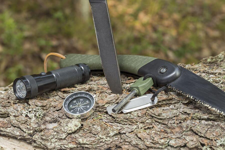 Knife compass flashlight