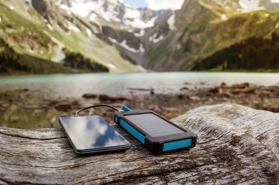 Battery Solar Energy Device On The Background Of Beautiful Mount